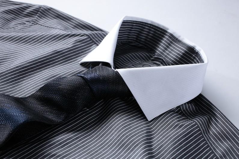 svart slips begravning